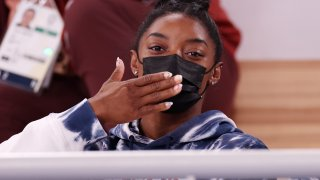 Simone Biles watches competition